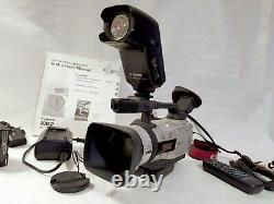 Canon DM-XM2 E PAL Camcorder + Light + High Capacity Battery + Charger + Extras