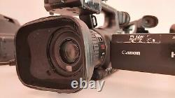 Canon XF100 Full HD Camcorder With charger, battery and two CF Cards