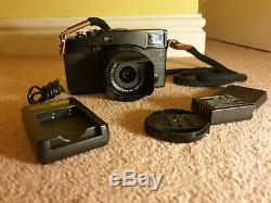 Fujifilm x-pro 1 with 18mm f2, box hood, 2 batteries, grip, charger and strap